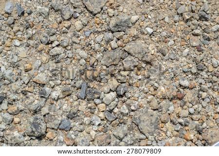 rounded pebble stones cement  - stock photo