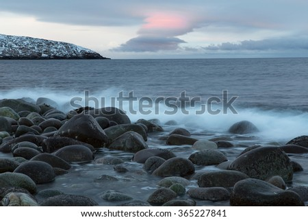 Rounded stones on the seashore. Barents Sea. Murmansk region. Russia.