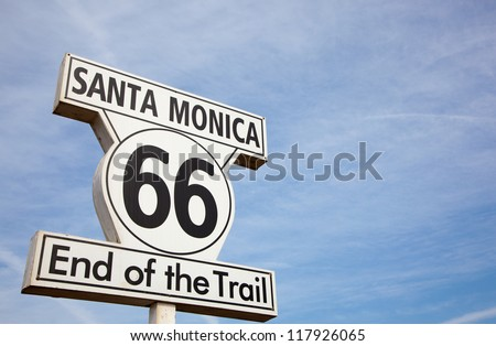 Route 66 highway sign at the end of Route 66 in Santa Monica California - stock photo
