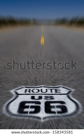 Route 66 pavement sign with Mojave desert - motion blur  - stock photo