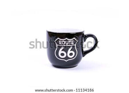 Route 66 sign on a single black mug. Isolated on white. - stock photo