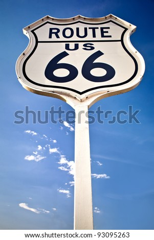 Route 66 sign on blue sky background - stock photo