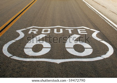 Route 66 sign on the road to Las Vegas, Nevada. - stock photo