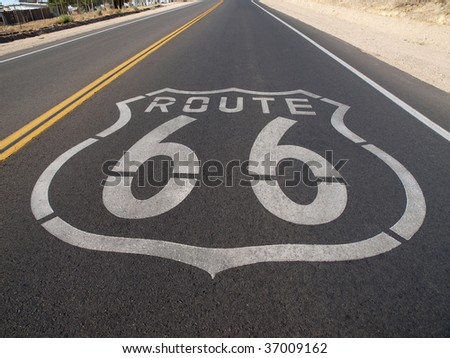 Route 66 sign painted onto the road pavement. - stock photo