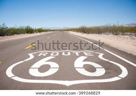 Route 66 sign writen on the asfault - stock photo
