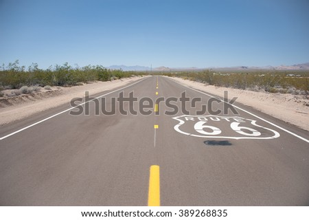 Route 66 sign written over the asphalt - stock photo