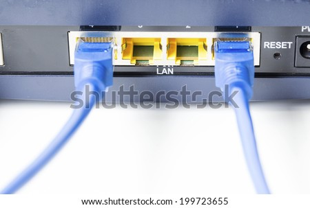 Router network hub with cable insert RJ45 port - stock photo