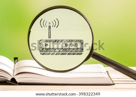 Router setup with a pencil drawing of a router icon in a magnifying glass - stock photo