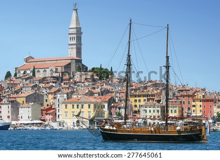 ROVINJ, CROATIA - JULY 26 : A galleass anchored in the Adriatic sea and the old city core with the Saint Euphemia church and bell tower in the background on July 26th, 2009 in Rovinj, Croatia.