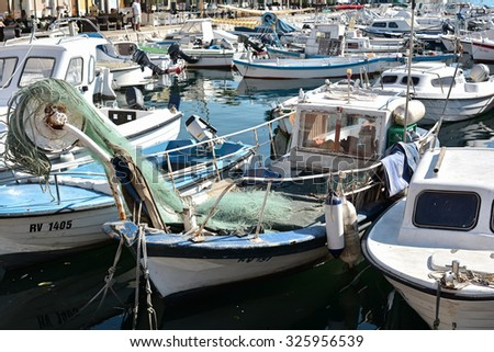 ROVINJ, CROATIA - JULY 14, 2015:  Boats in the port of Rovinj in Croatia