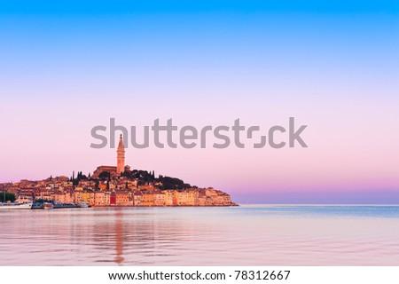 Rovinj old town in Adriatic coast of Croatia in sunrise light. Popular touristic destination at Istria region. - stock photo