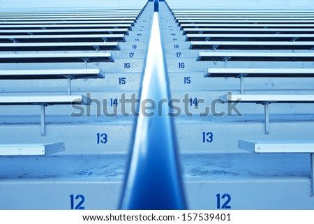 Row after Row of Stadium bleachers and seating - stock photo