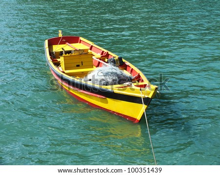 row boat anchored - stock photo