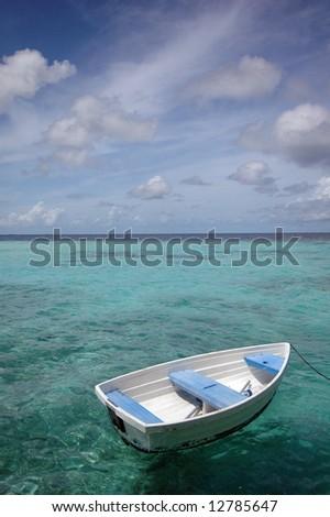 Row boat on the sea - stock photo