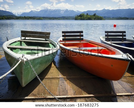 row boats at a lake