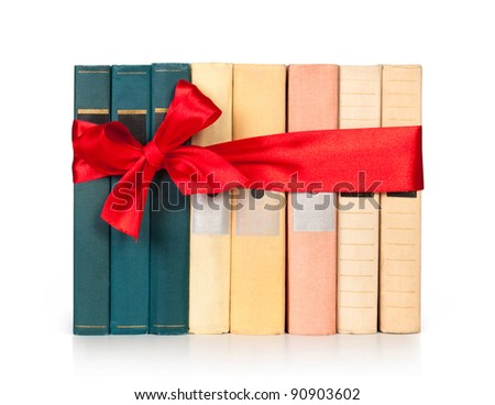 row books with ribbon like a gift isolated on white - stock photo