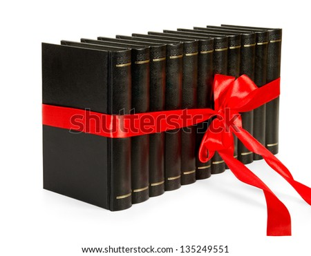 Row books with ribbon like a gift isolated on white background. - stock photo