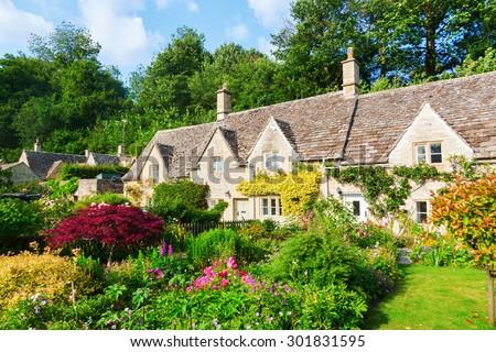 row cottages in Bibury, Gloucestershire, England - stock photo