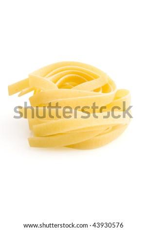 row dry nest pasta on white - stock photo