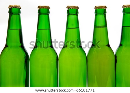 Row from beer bottles. Isolated on white background