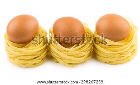 Row from three italian pasta in form nest and brown egg isolated on white background - stock photo