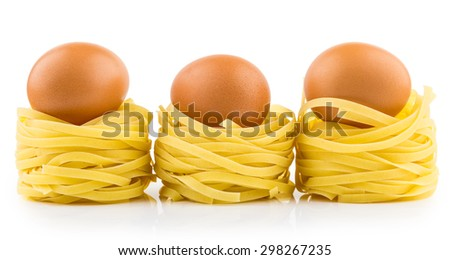 Row from three pasta in form nest and egg with reflection isolated on white background - stock photo