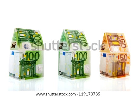 Row green and orange money houses from European banknotes - stock photo