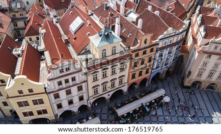 Row houses with traditional red roofs, Old Town Square, Prague, Czech Republic. - stock photo