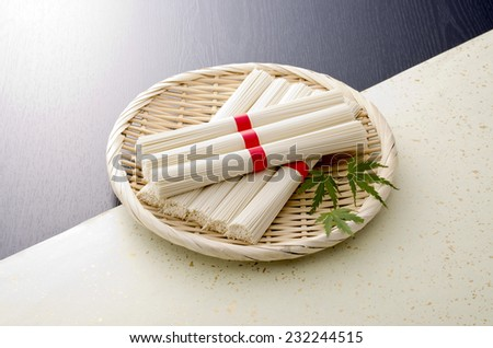 row japanese fine white noodle on a bamboo sieve basket - stock photo