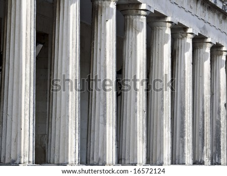 Row of Ancient Greek temple pillars. British palace detail at Corfu island in Greece - stock photo