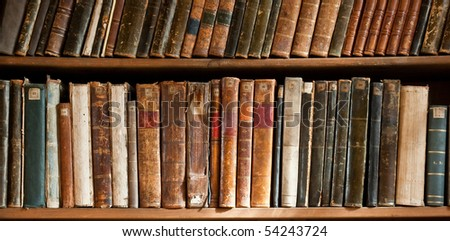 Row of Antique Books in Library - stock photo