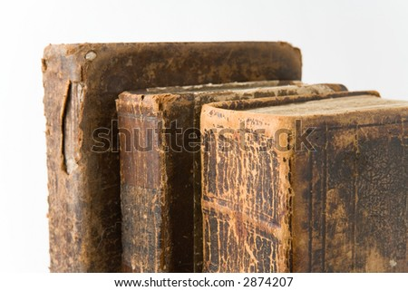 Row of antique books on a white background