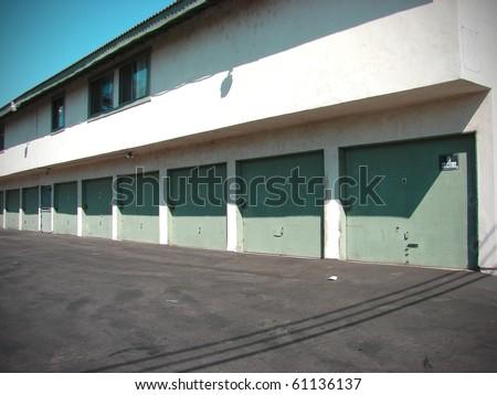 row of apartment garage doors in alley - stock photo