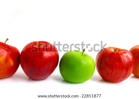 row of apples on white, one green apple