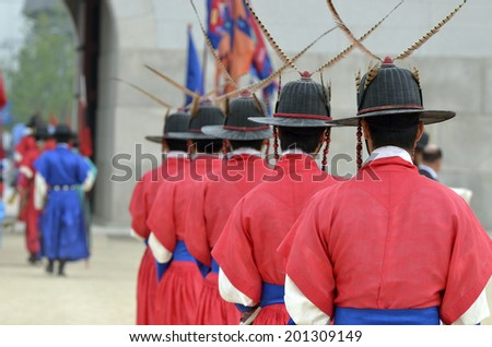 Row of armed guards in ancient traditional soldier uniforms in the old royal residence, Seoul, South Korea  - stock photo