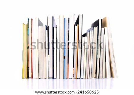 Row of art magazines on white background - stock photo
