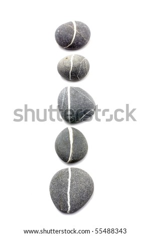 Row of assorted pebbles isolated on a white - stock photo