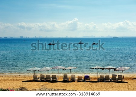 Row of Beach Chairs for a Summer Vacation - stock photo