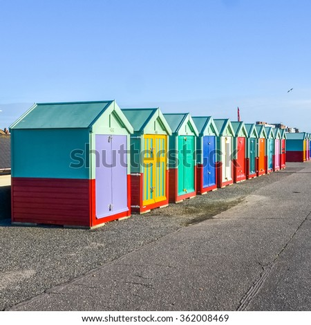 Row of beach huts on sea front in Worthing, Sussex, England