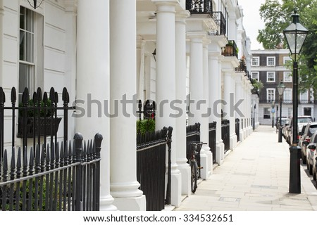 Row of beautiful white edwardian houses in Kensington, London  - stock photo