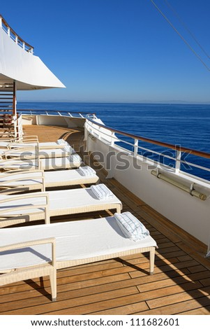 row of beds on the ship deck