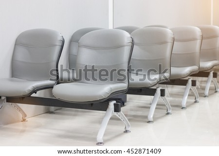 row of bench in the terminal of airport. empty chair in airport terminal waiting area with chairs. - stock photo