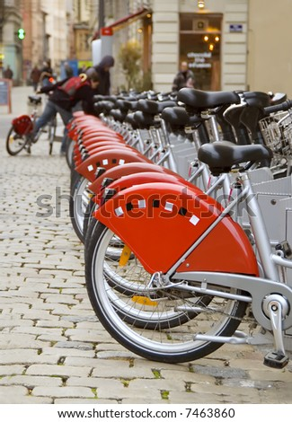 Row of bicycles (partial view) enviromentaly save variant of city transportation - stock photo