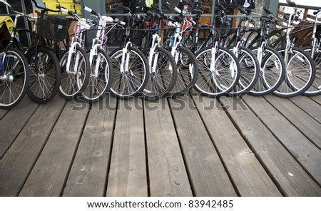 Row of bikes available to rent or sell