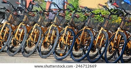 row of bikes in a rental agency. Shot in Sardinia, Italy - stock photo
