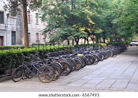 row of bikes parked behind apartment building, Beijing, China