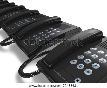Row of black office phones - stock photo