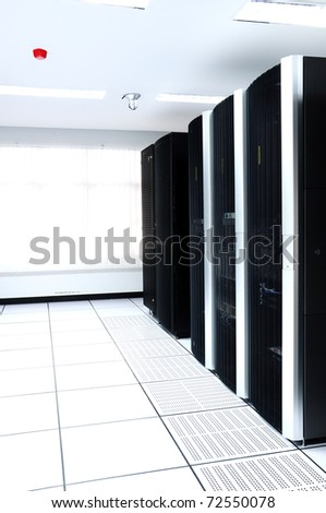 Row of black servers in internet data center