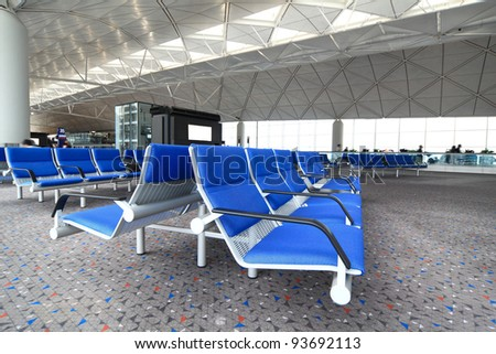 row of blue chair at airport - stock photo