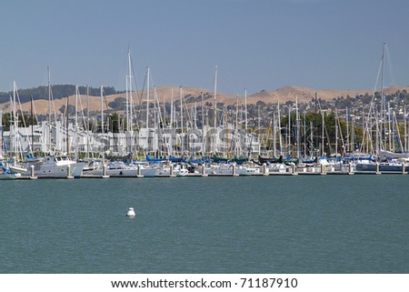 Row of boats on the pier on sunny day - stock photo
